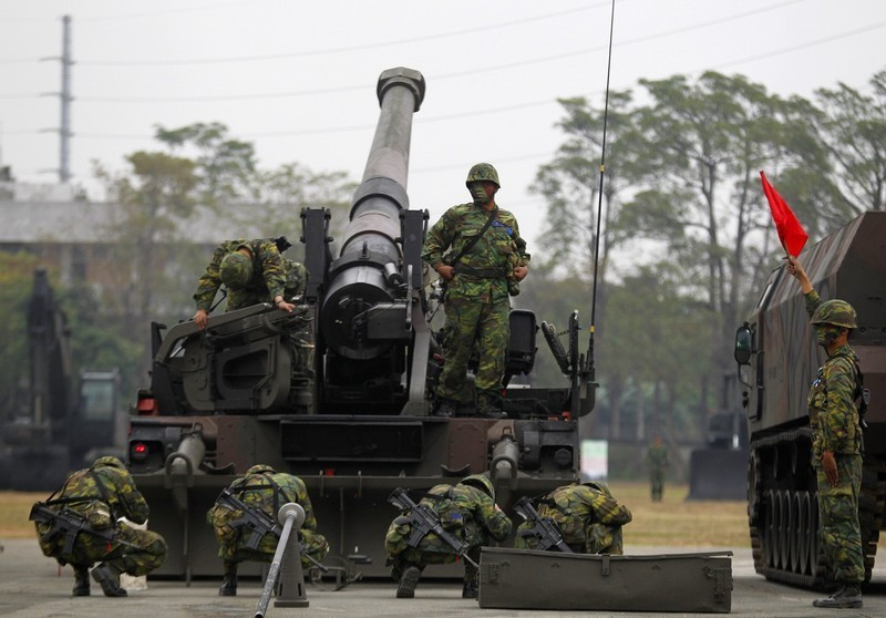 Soldiers operate an M10 tank destroyer during a military exercise at an army base in Kaohsiung County, southern Taiwan