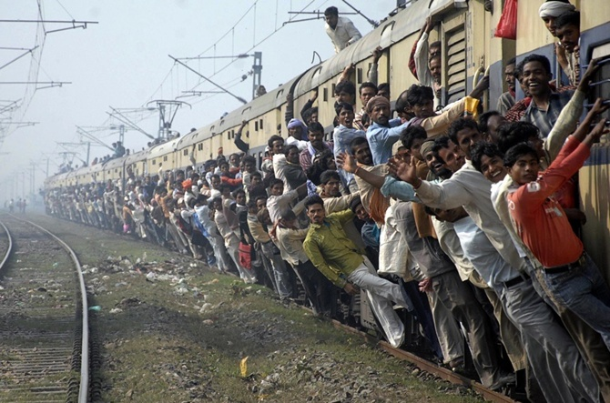 Passengers travel in an overcrowded train in Patna