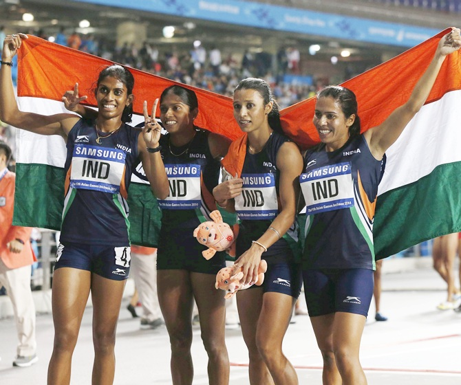 India's Pawar Priyanka, Lukka Tintu, Kaur Mandeep and Poovamma Raju Machettira celebrate winning the women's 4x400m relay final at the Incheon Asiad Main Stadium during the 17th Asian Games
