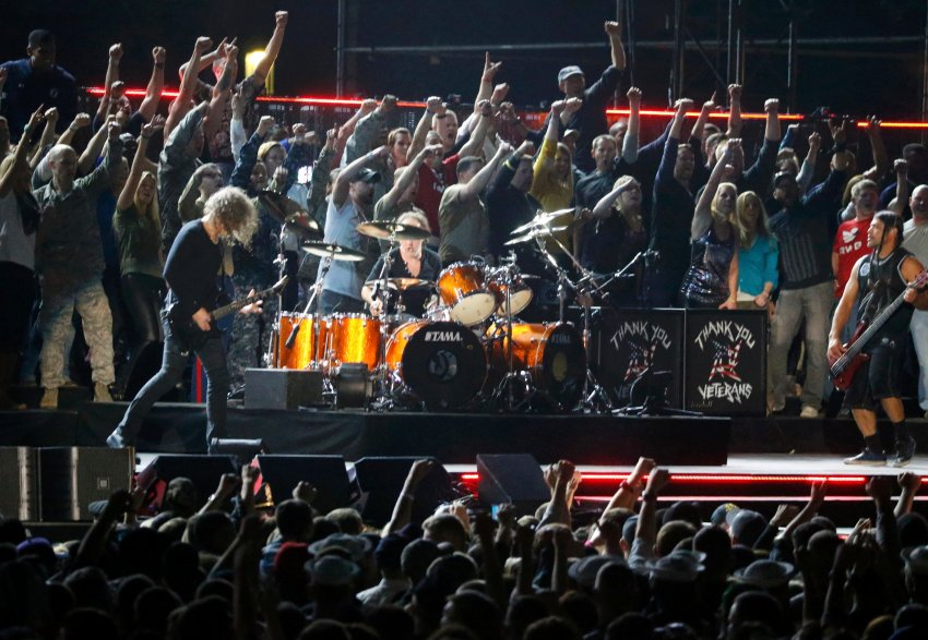Metallica performs with U.S. military personnel during the Concert for Valor on the National Mall on Veterans' Day in Washington