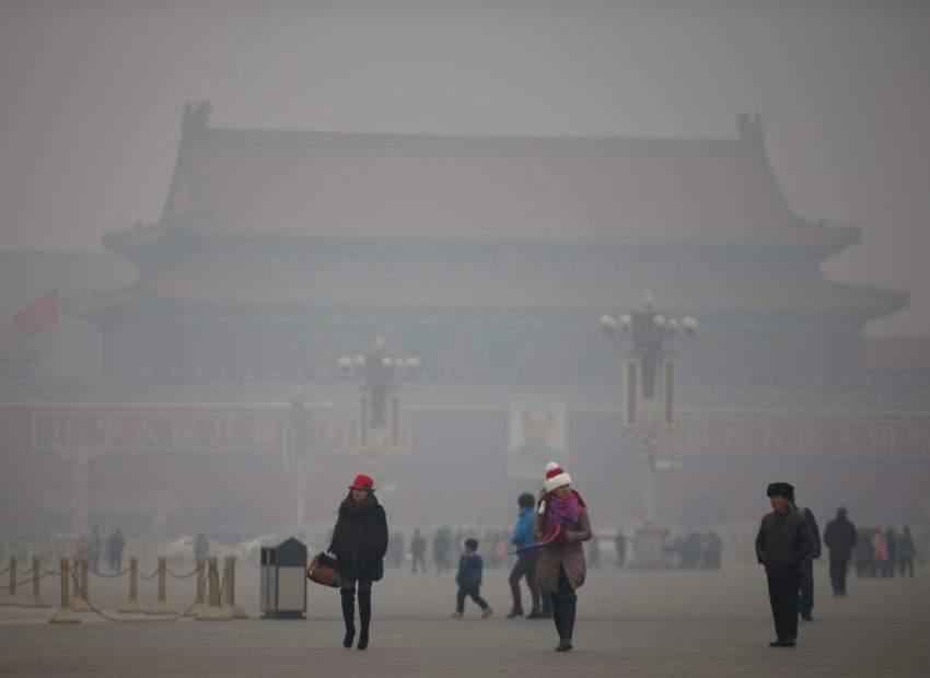 Visitors take a walk during a polluted day at Tiananmen Square in Beijing