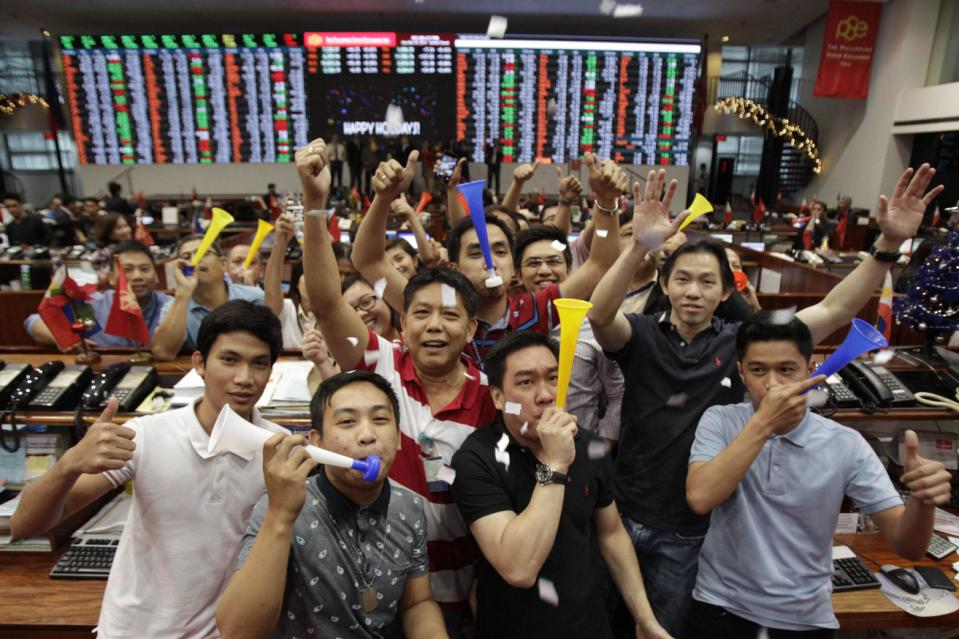 Traders blow horns at the trading floor of the Philippine Stock Exchange in Makati city