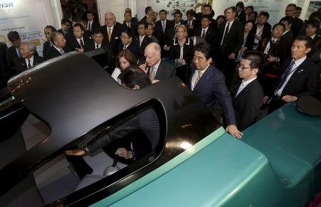 File photo of California Governor Jerry Brown and Japanese Prime Minister Shinzo Abe getting a demonstration of the JR-East Shinkansen train simulator at the Fairmont Hotel in San Francisco