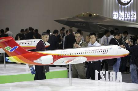 Visitors look at a model of the ARJ21 regional jet from Commercial Aircraft Corp of China at the Aviation Expo China 2015 in Beijing