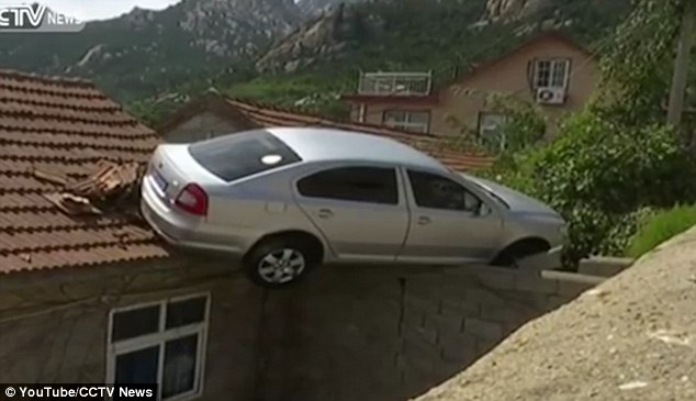 389c322600000578-3798297-the_car_is_seen_smashing_onto_the_roof_and_hanging_on_the_wall_s-a-53_1474383815647